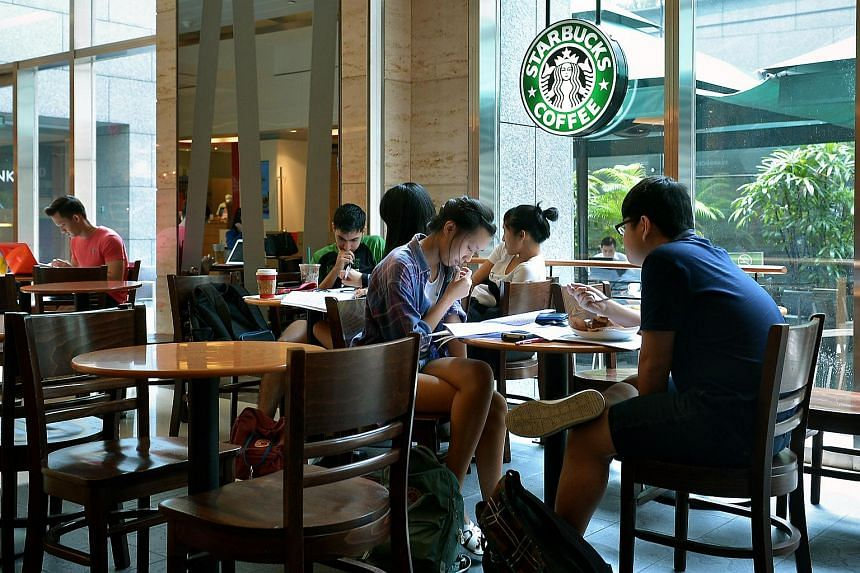 Customers at a Starbucks outlet in City Link Mall.