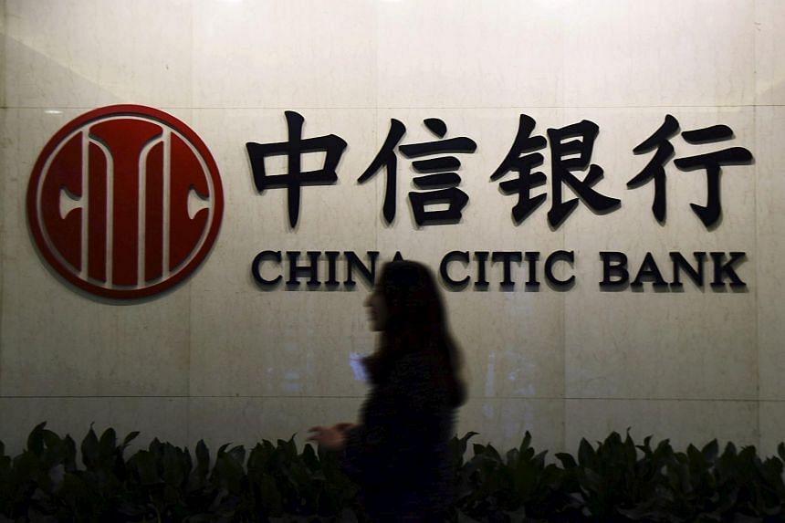 A customer walking past the company logo of China Citic Bank in Hangzhou, Zhejiang province, China.