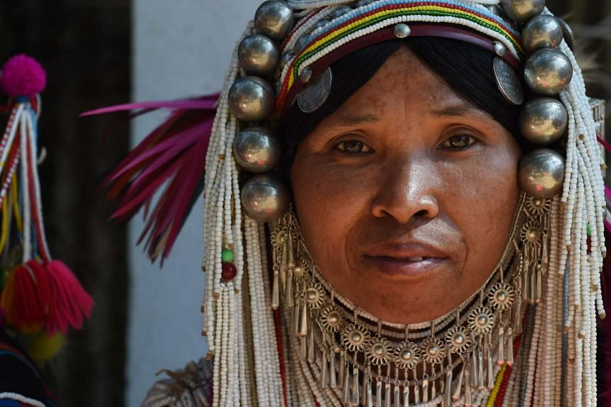 A Shan ethnic woman from the Akha hill tribe wearing traditional costumes.
