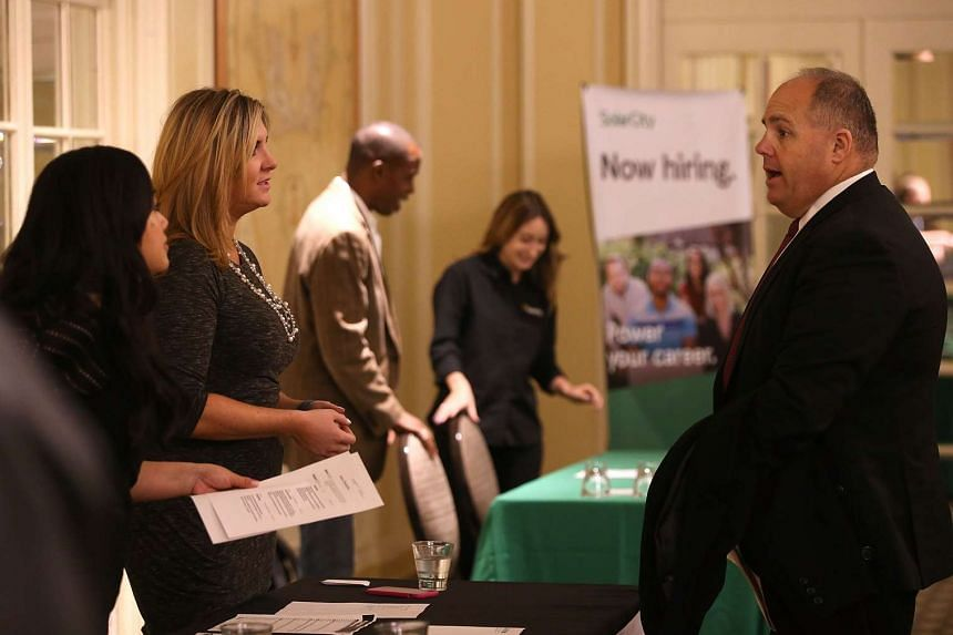 A job seeker meets with recruiters during the HireLive Career Fair in San Francisco, California.