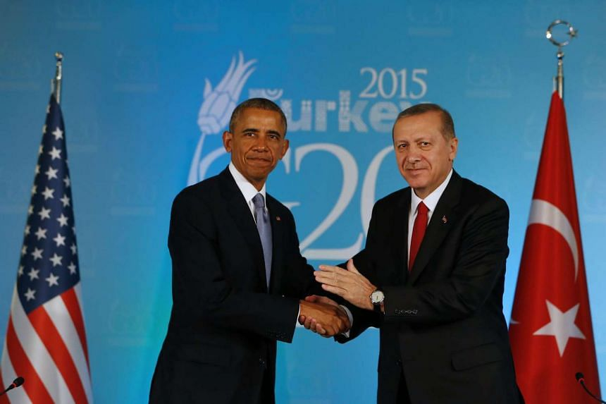 Turkish President Recep Tayyip Erdogan (right) shakes hands with US President Barack Obama during a G20 press conference on Nov 15, 2015.