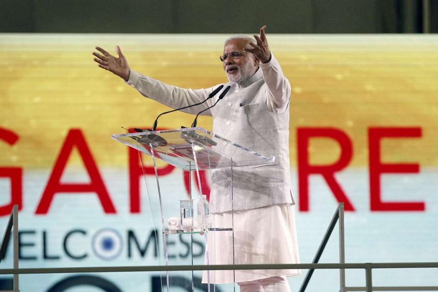 India's Prime Minister Narendra Modi delivers an address at a community event in Singapore on Nov 24, 2015.