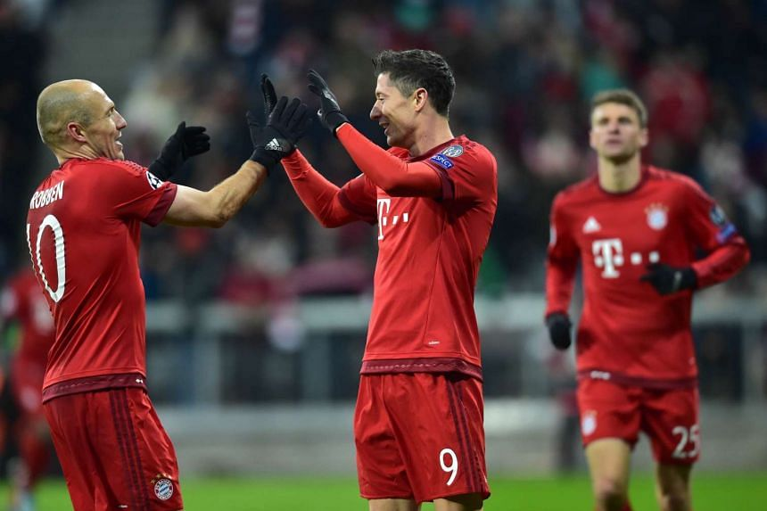 (From left) Bayern Munich's Arjen Robben, Robert Lewandowski and Thomas Mueller react after scoring during the Uefa Champions League Group F football match between Olympiakos.