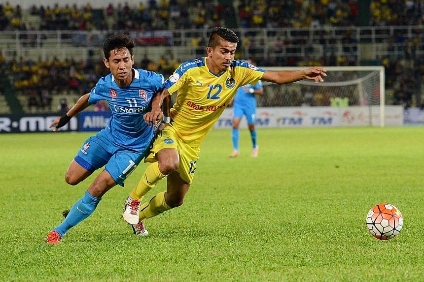 Azammuddin Akil (right) thwarting LionsXII's Nazrul Nazari in a chase for the ball. The hungrier and faster Pahang players were a real handful for the Singapore team, who need to improve tremendously on Saturday.