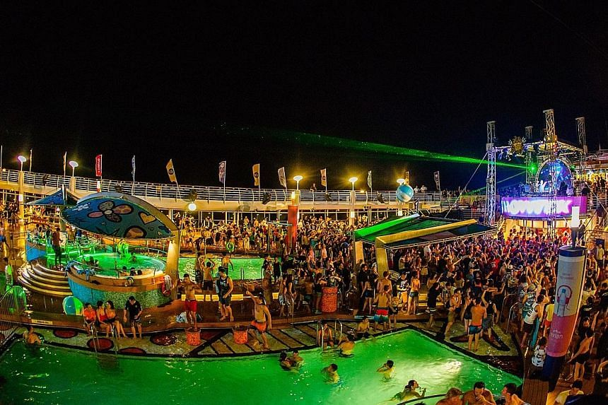Dutch DJs Showtek took the stage on the ship (above right) on the first day; and partygoers with DJ Kaskade in Langkawi.