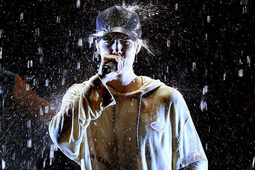 The chart is currently led by singer Justin Bieber (above).