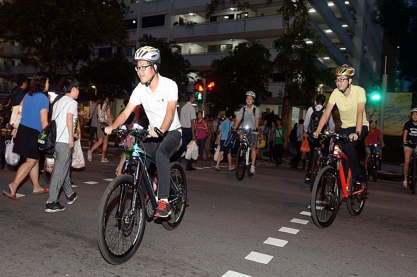 Focus group participants on bicycles in a role-playing exercise in Yishun Ring Road yesterday. Participants used bicycles or other personal mobility devices and also rode on crowded footpaths.