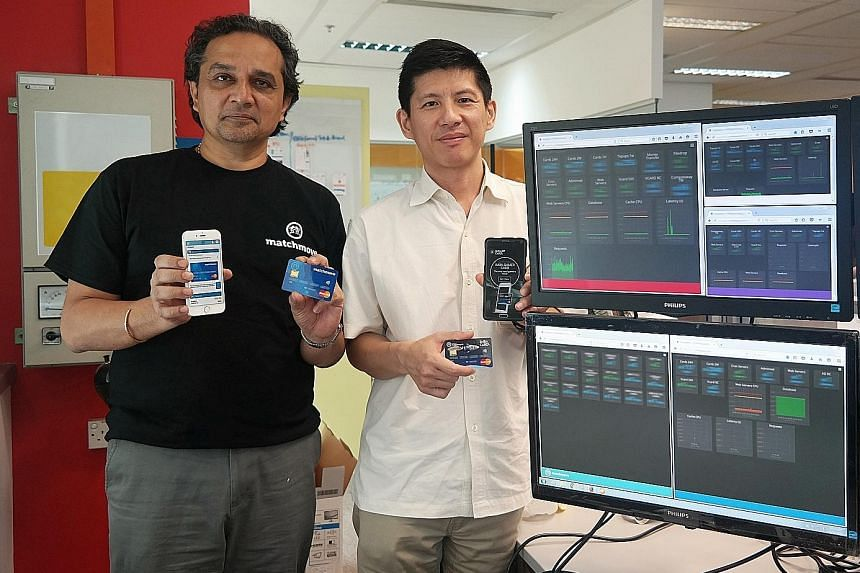 MatchMove Pay's CEO Shailesh Naik (left) and chief operating officer Hsueh Huah Leow with their firm's flagship innovation, the MatchMove virtual card, and its latest product, the MatchMove card, which is the physical version of the virtual card.
