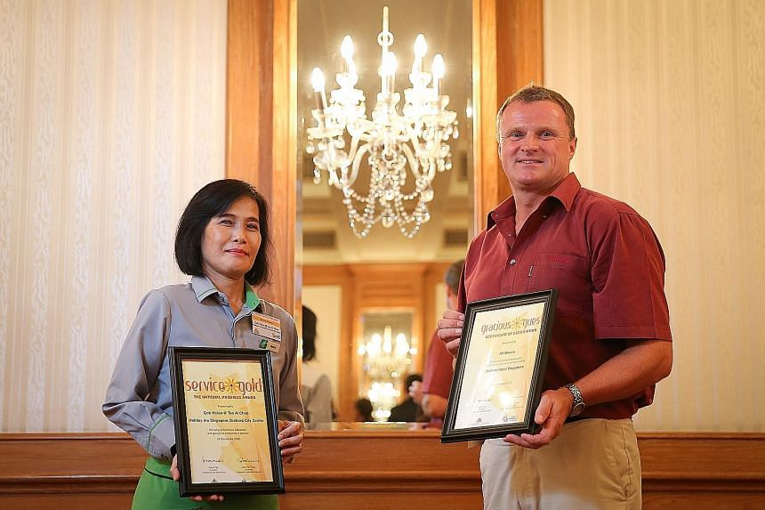 Restaurant employee Helen Goh won a gold award for service, while engineer Ad Broere won an award for being a gracious hotel guest.
