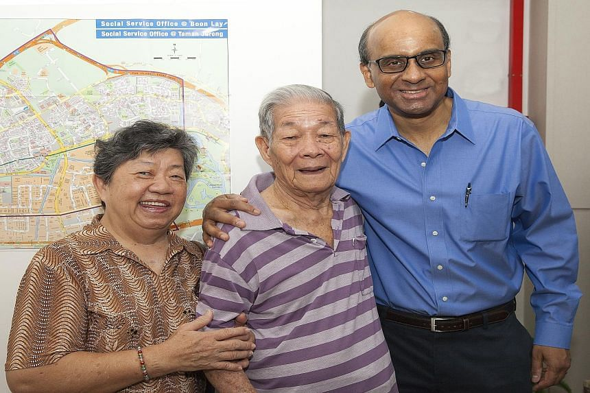 DPM Tharman Shanmugaratnam (at right) with Taman Jurong residents and Cluster Support beneficiaries Madam Lau Kang Ngoh, 69, and her husband Ching Chen Chooi, 89, at NTUC Health's new Cluster Support office.