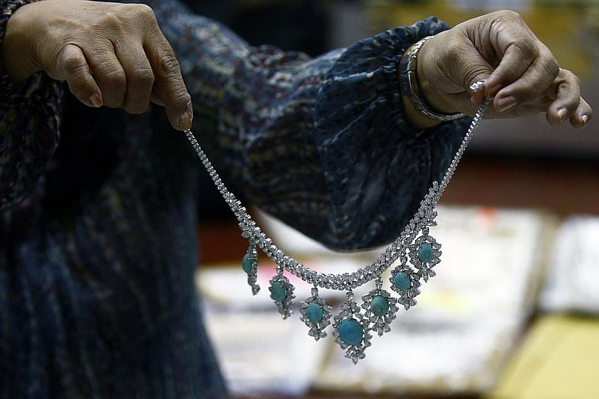 A necklace seized three decades ago from Imelda Marcos, former first lady of the Philippines, being displayed during an appraisal at the Central Bank of the Philippines in Manila yesterday. In a statement, the Presidential Commission on Good Governme