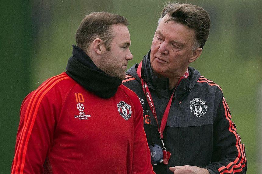 Wayne Rooney, with Louis van Gaal, in training ahead of the PSV match.