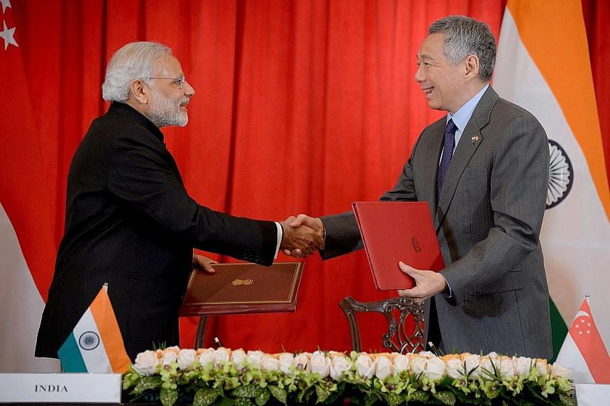 Indian Prime Minister Narendra Modi and Singapore PM Lee Hsien Loong at the signing of the strategic partnership agreement at the Istana yesterday.