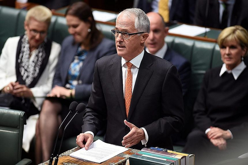Australian Prime Minister Malcolm Turnbull speaking to Parliament in Canberra yesterday. Although he ruled out the use of Australian troops on the ground in Syria or Iraq, he said his government was planning greater intelligence-sharing with South-ea