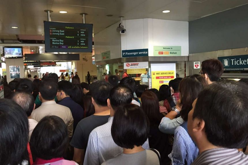 Commuters head into Bishan MRT station after train services resumed following a breakdown.