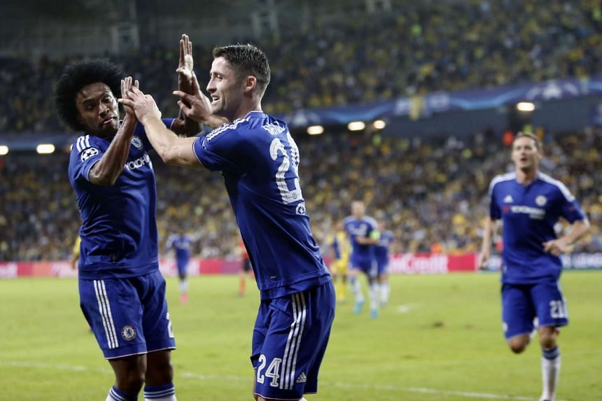 Chelsea's Gary Cahill (right) celebrates with his teammate Willian after scoring a goal during their Uefa Champions League match between Maccabi Tel Aviv.