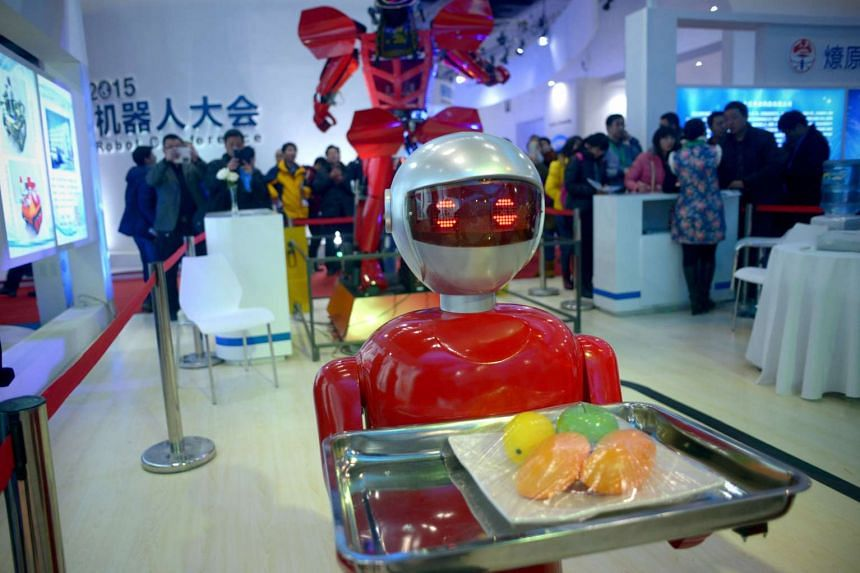 A robot carrying fruits is displayed at the World Robot Conference in Beijing on Nov 24.