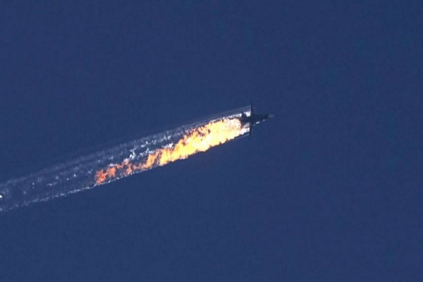 A still image made available on Nov 24, 2015, from video footage shown by the HaberTurk TV Channel of a burning trail after the plane was shot down near the Turkish-Syrian border.