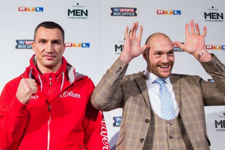Klitschko (left) and British contender Fury pose in Duesseldorf, Germany.