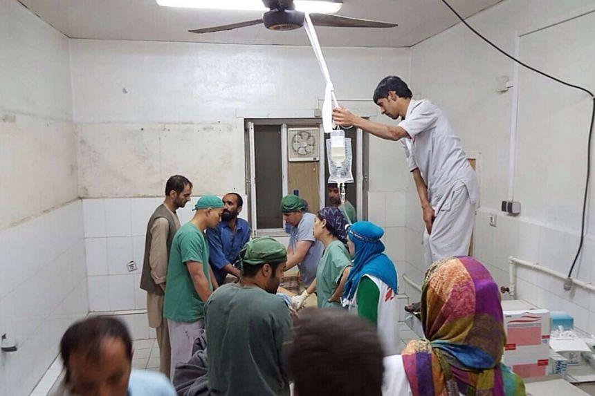 Surgeons work in an undamaged part of the hospital in Kunduz after it was hit.