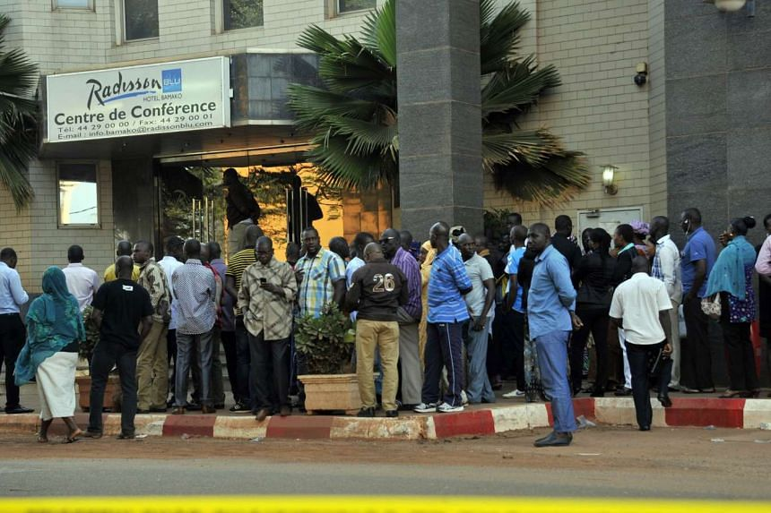People gathering at the entrance the Radisson Blu hotel in Bamako on Nov 24, 2015, in tribute to the victims.