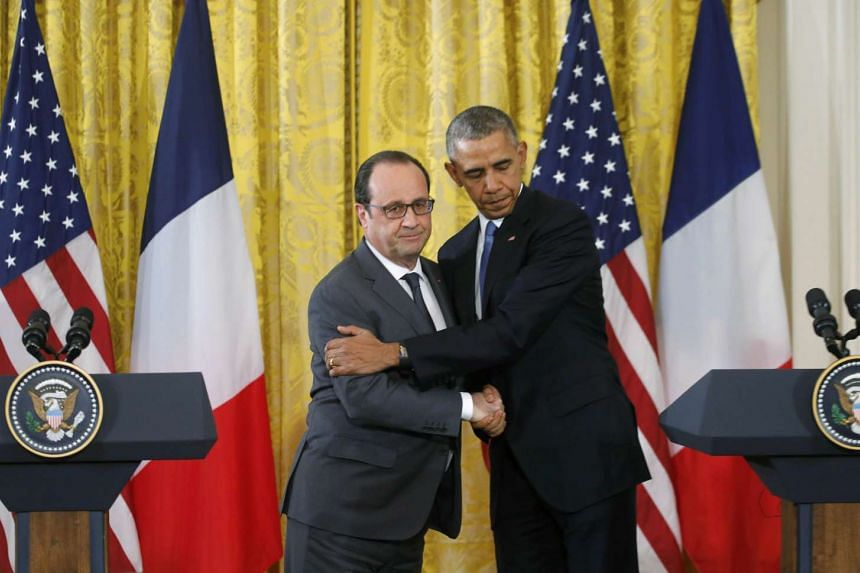 French President Francois Hollande and United States President Barack Obama embrace after their White House meeting.
