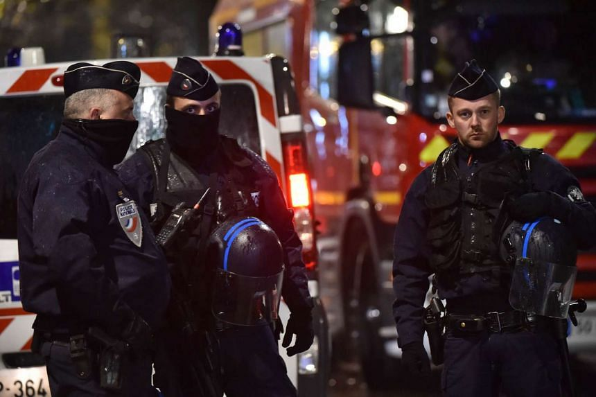 Police cordon off an area near the hostage situation in the French town of Roubaix on Nov 24.