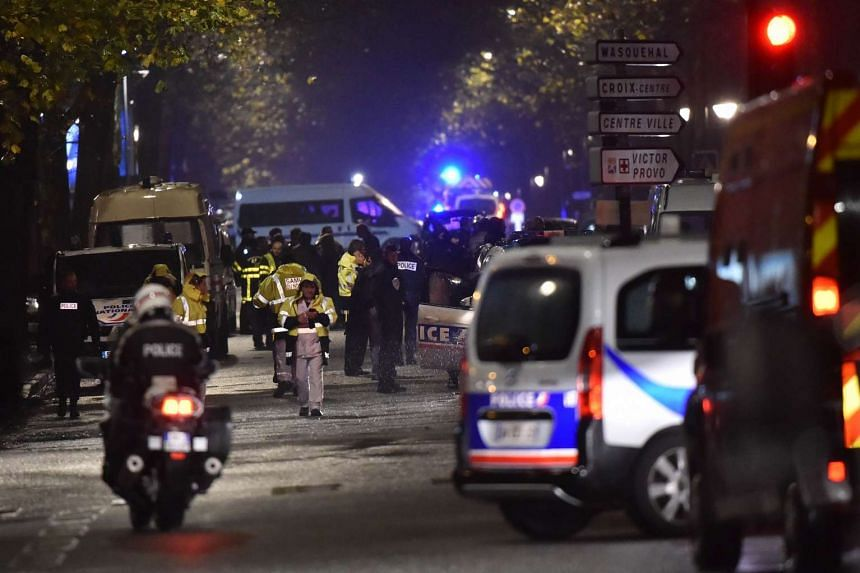 Police cordon off the area close to where armed men took hostages in the northern French town of Roubaix.