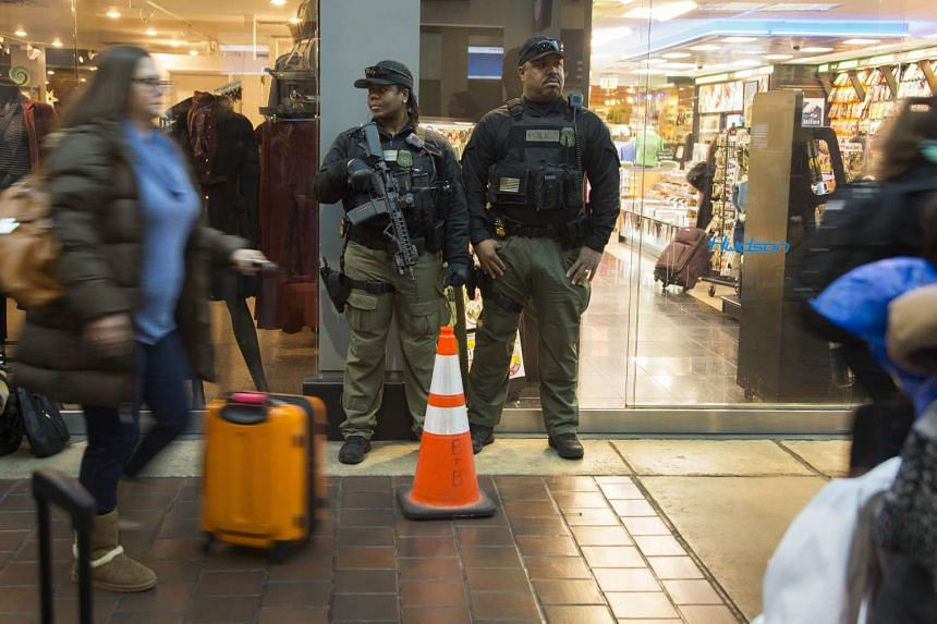 Heavily armed police stand guard in Union Station in Washington, DC on Nov 24, 2015.