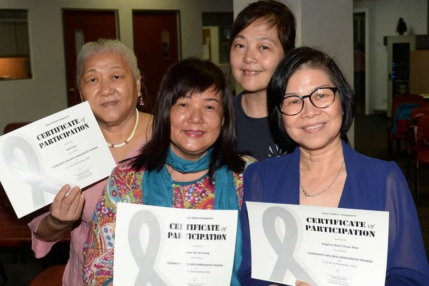 Community Wellness Ambassador programme graduates with their certificates of participation. From left: Madam Julie Chew, 65, retiree; Madam Agnes Tan, 60, housewife; Madam Molly Tan, 52, self-employed; and Madam Angeline Bock, 57, telephone operator.