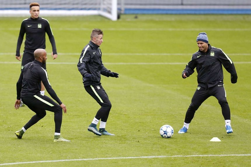 Man City's Sergio Aguero (left) and Fabian Delph (far left) during training. Having qualified for the last 16, City want a win in Turin tonight to seal top spot in Group D and avoid top guns in the last 16.