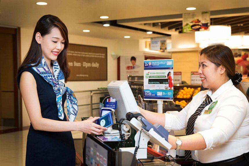 The new app lets UOB customers make contactless payments with their smartphones at the point of sale.