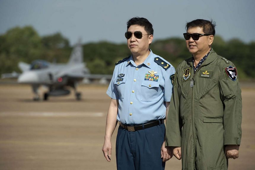 Thai Air Marshal Bhanupong Seyayongka (right) and Chinese deputy chief of staff Feng Aiwang at the start of a joint exercise at a Korat air base on Nov 24.