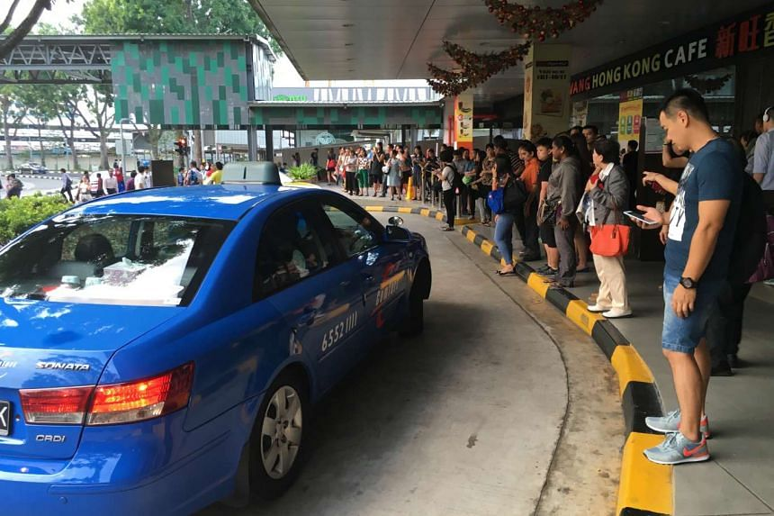 Queues formed at a taxi stand at Yishun bus interchange.