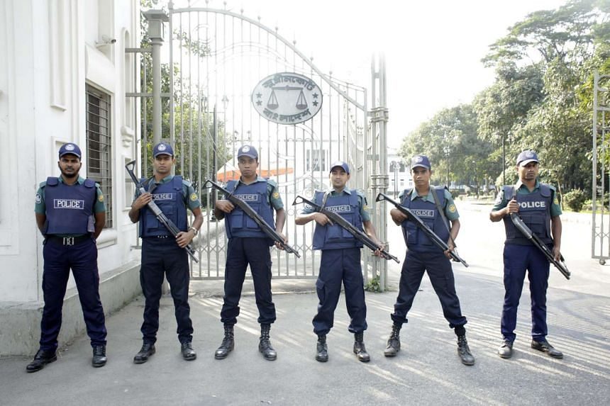 Bangladesh policemen stand guard in front of the Supreme Court during a strike.