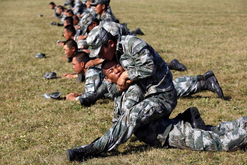 Chinese People's Liberation Army (PLA) soldiers training at their barracks in Heihe.