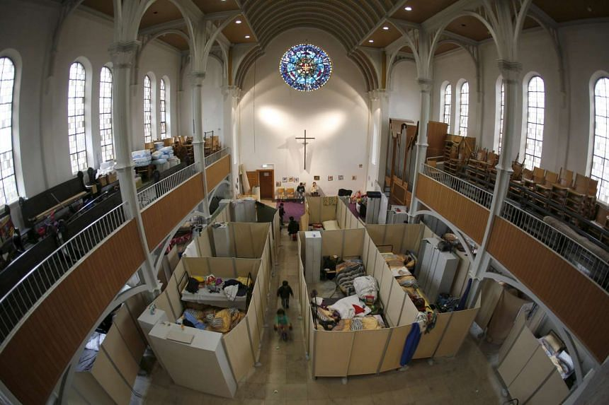 Beds for migrants are set up inside a Protestant church in Oberhausen, Germany.