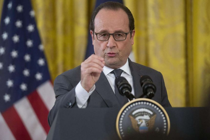French President Francois Hollande speaking at a news conference at the White House in Washington, DC, on Nov 24.