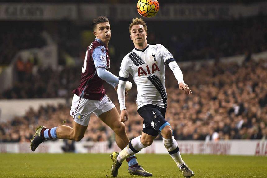 Aston Villa's Jack Grealish  in action with Tottenham's Christian Eriksen.