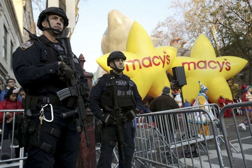 Members of the New York Police Department's Emergency Service Unit stand guard before the 89th Macy's Thanksgiving Day Parade.