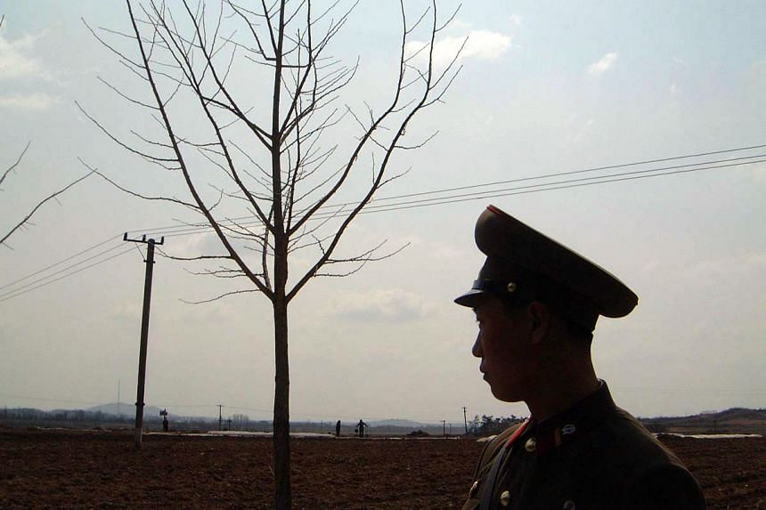 A North Korean soldier looking out at Panmunjom.