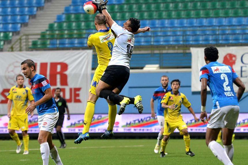 Balestier Khalsa goalkeeper Zaiful Nizam (in white) foiling Tampines Rovers' striker Mateo Roskam (No.9) during an S-League match at Jalan Besar Stadium on Aug 21, 2015.