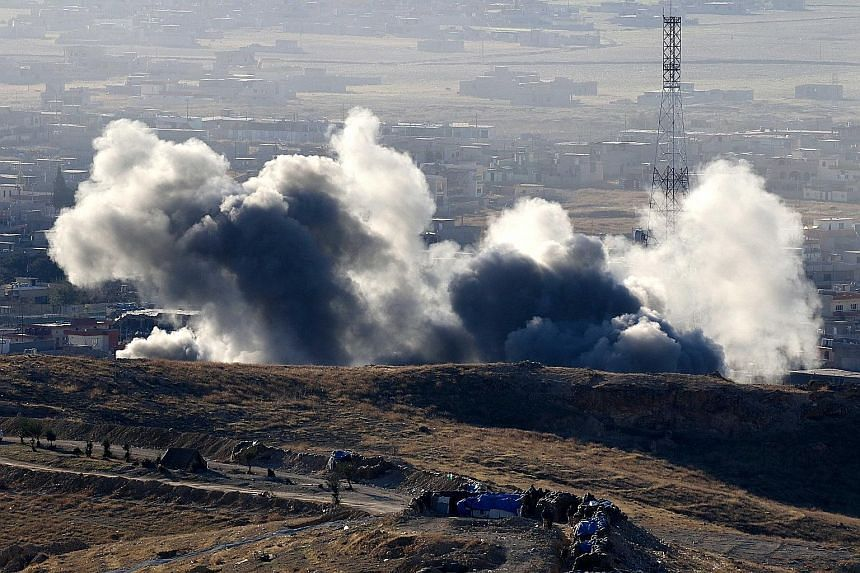 Smoke rising from the northern Iraqi town of Sinjar during an operation earlier this month by Iraqi Kurdish forces, backed by US-led strikes, to retake the town from ISIS and cut a key supply line to Syria.