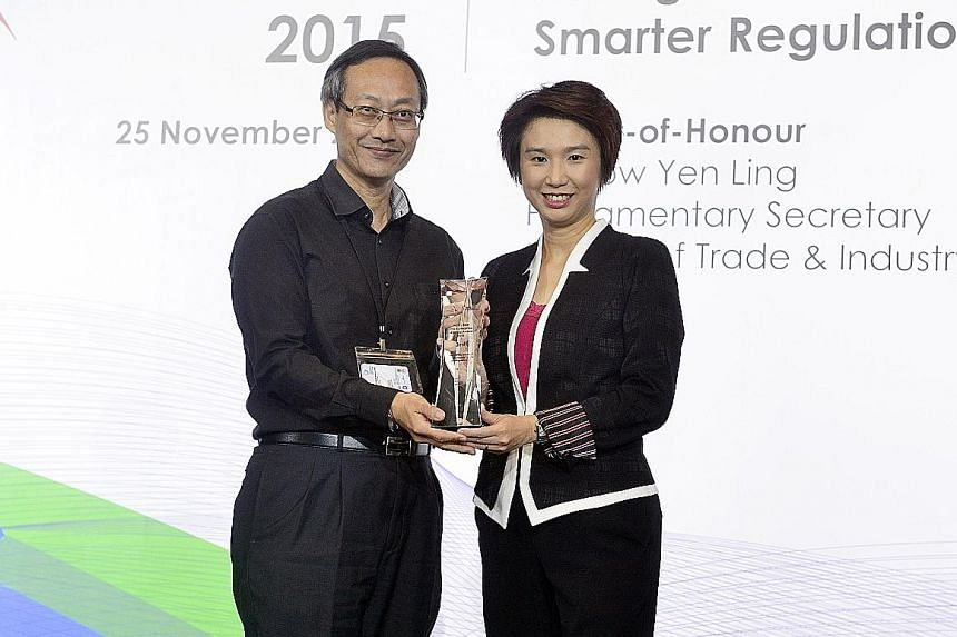 Ms Low Yen Ling, Parliamentary Secretary for Trade and Industry and for Education, presenting the PEP-SBF Most Improved Agency Award to Mr James Khor, Iras' deputy commissioner, yesterday.