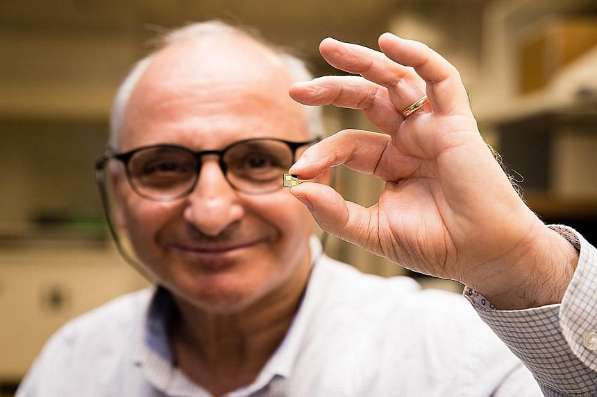 Prof Rachid Yazami holding the smart chip he developed. Embedded in a rechargeable battery, the chip optimises how the battery is charged and can reduce charging time to 10 minutes or even less, says the NTU researcher. (Below) The chip compared to a