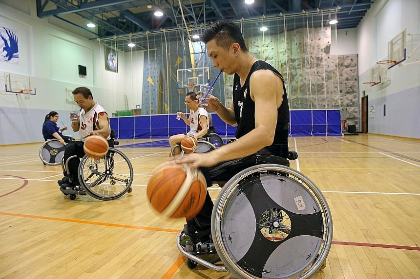 One of the players straps his legs tightly to the wheelchair as sudden upper body movements may cause a player to fall out of his wheelchairs.