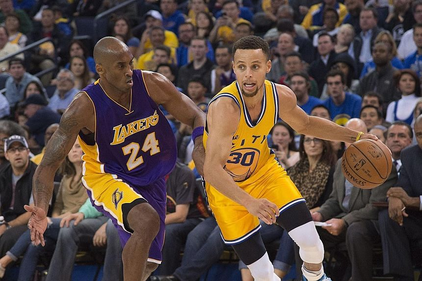 Stephen Curry (No. 30) has things under control against Los Angeles Lakers forward Kobe Bryant, as the all-conquering Golden State Warriors easily overwhelm their rivals 111-77 at home.