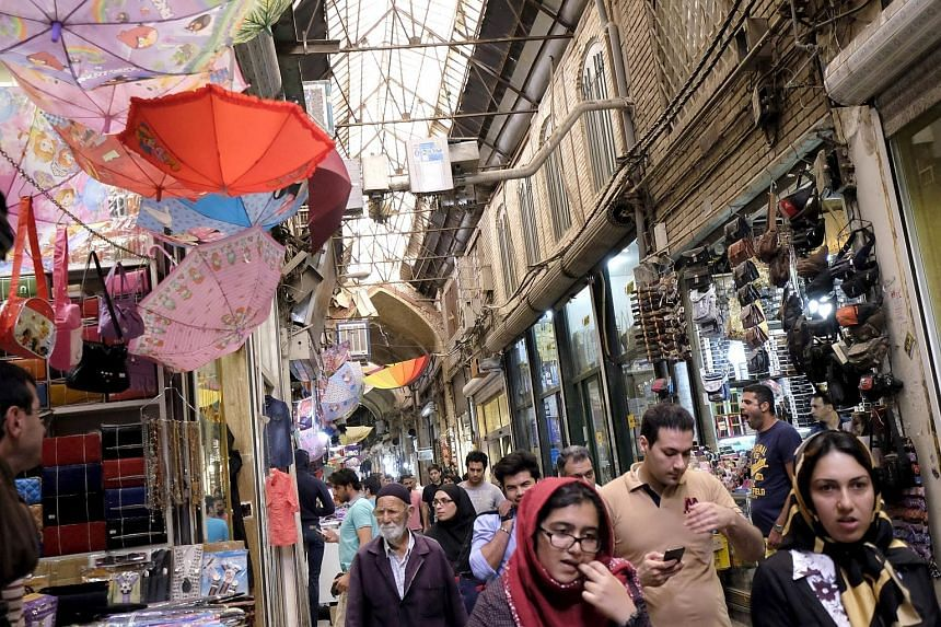 Shoppers at the Grand Bazaar in central Teheran. Iran has a large, developed domestic market and a young, educated population, factors that make it an attractive proposition to South-east Asian businesses looking for new markets or to expand abroad.