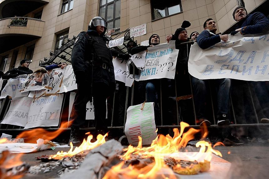 An anti-Turkey protest outside the Turkish Embassy in Moscow yesterday. Russian Prime Minister Dmitry Medvedev warned that Turkish companies may lose their position in the Russian market and important joint projects may be halted because of the breac