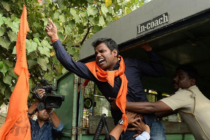 An Indian activist shouts slogans as he is detained by police outside the home of Bollywood actor Aamir Khan in Mumbai on Tuesday. Khan had complained of rising intolerance in his homeland. Bollywood actor Aamir Khan, who is Muslim, and his Hindu wif